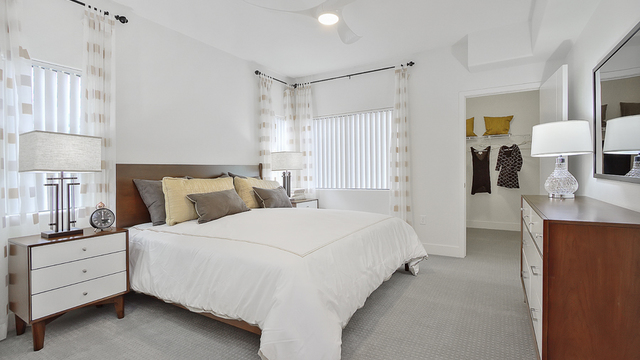 Evolve Apartments - Bedroom with White Furnishings in View