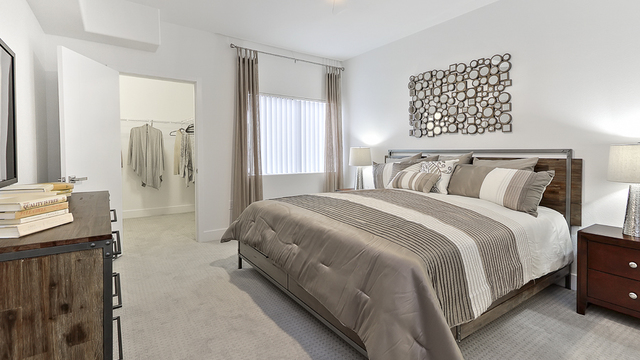 Evolve Apartments - Interior of Bedroom with Grey Furnishing
