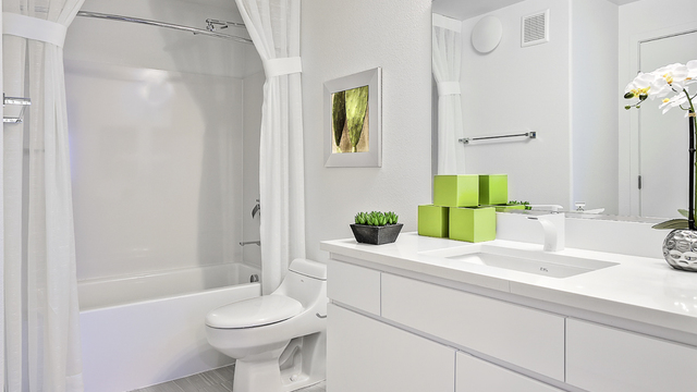 Evolve Apartments - Bathroom with Toilet, Sleek Fixtures, and Furnishing