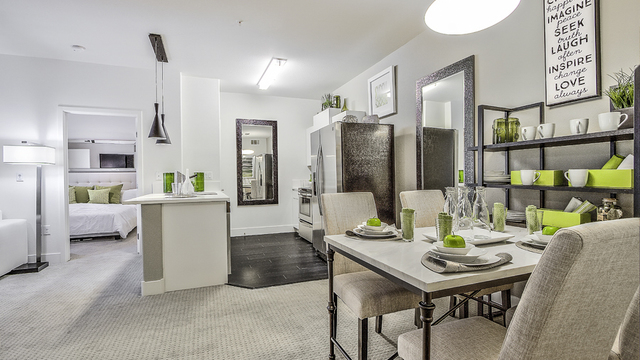 Evolve Apartments - Apartment Dining Room with Green & White Furnishing and a visible Kitchen & Room.
