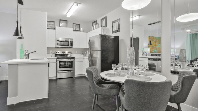 Evolve Apartments - Dining Room with Grey and White Furnishing, Kitchen, and Living Room