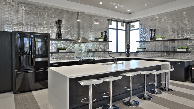 Evolve Apartments - Kitchen with Black & Grey Furnishing, Bar, and Barstools